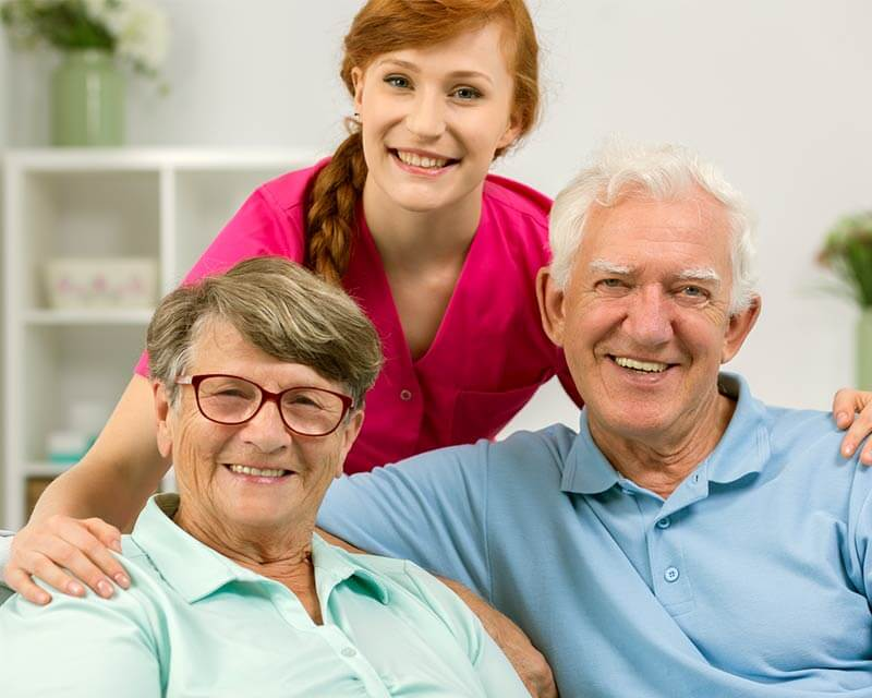 Caregiver with client couple