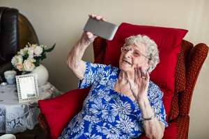 Senior woman on smart phone - technology for seniors - in home supportive services orange county