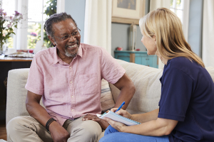 caregiver talking with senior client